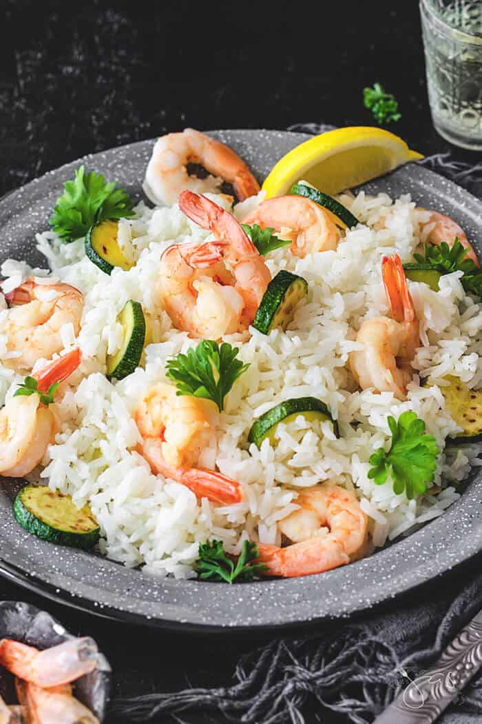 A front shot of Italian dish with rice, shrimp, and zucchini.