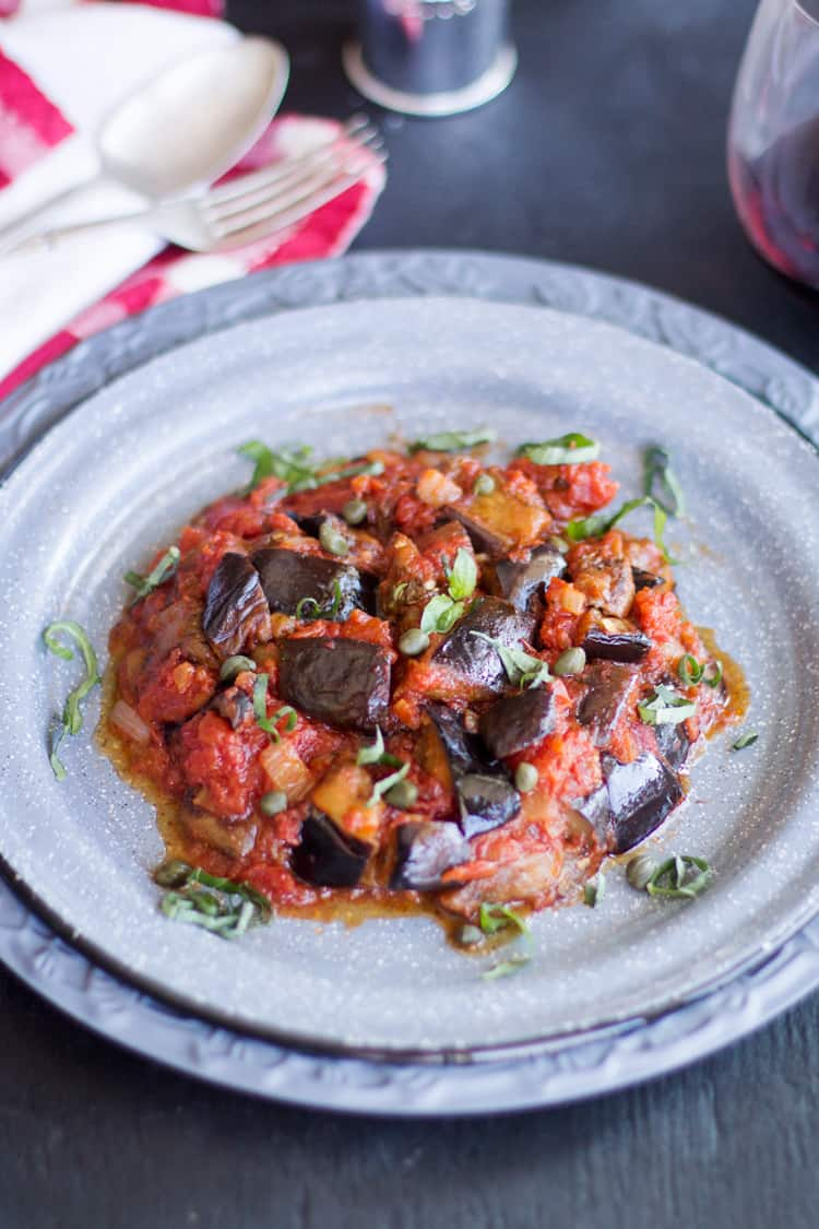 A plate of food on a table, with Caponata