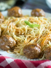 A close up of pasta and meatballs in a platter