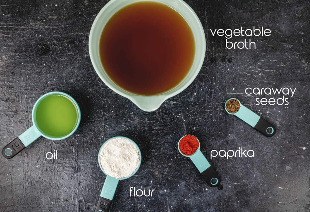 Ingredients for this Croatian soup recipe, with flour, caraway seeds, and oil.