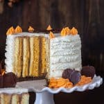A shot of the cake's inside with orange and chocolate vertical layers