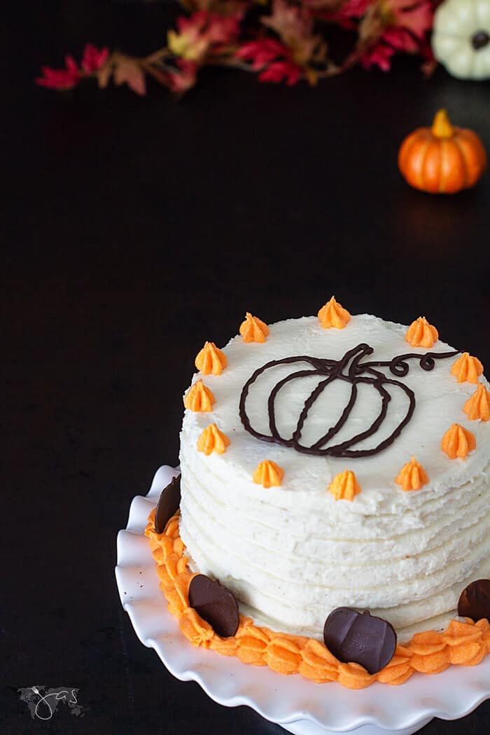 A view of the cake decorated with chocolate pumpkin.