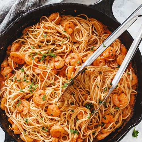 Angel hair pasta with spicy shrimp scampi in a cast iron skillet