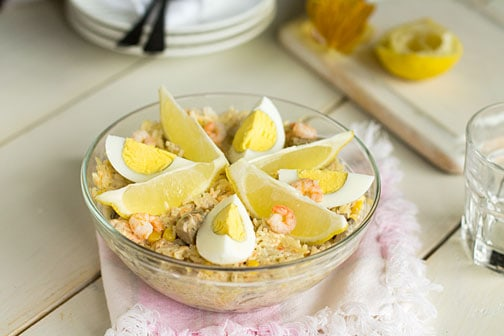 A bowl of shrimp and rice salad.