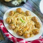 A plate of spaghetti and meatballs