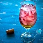 A glass of peach Bellini
