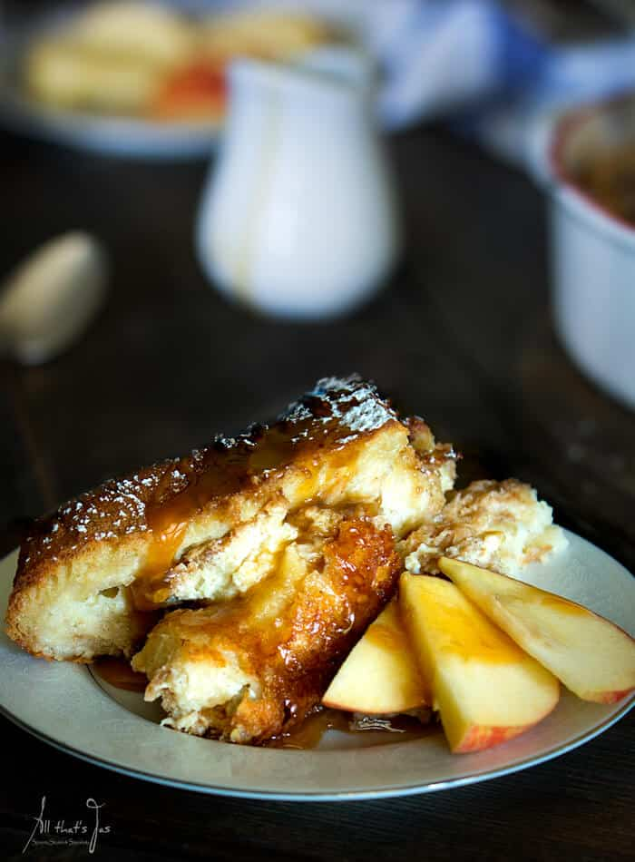 A plate with bread pudding and apple slices
