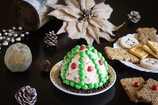 A Christmas cheese ball with decorations