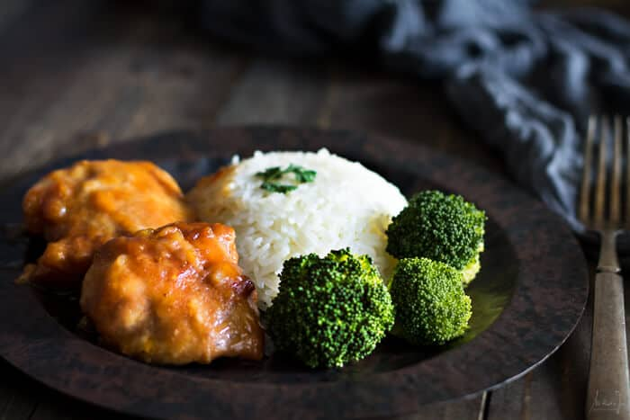 Chinese sticky chicken served with broccoli and rice.