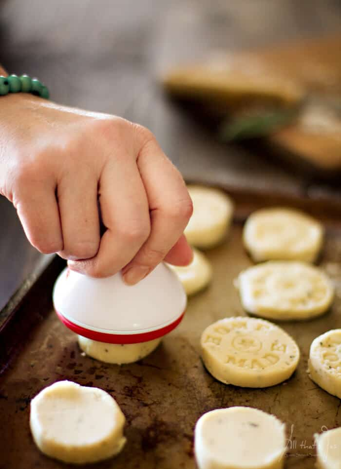 Pressing the shortbread cookies