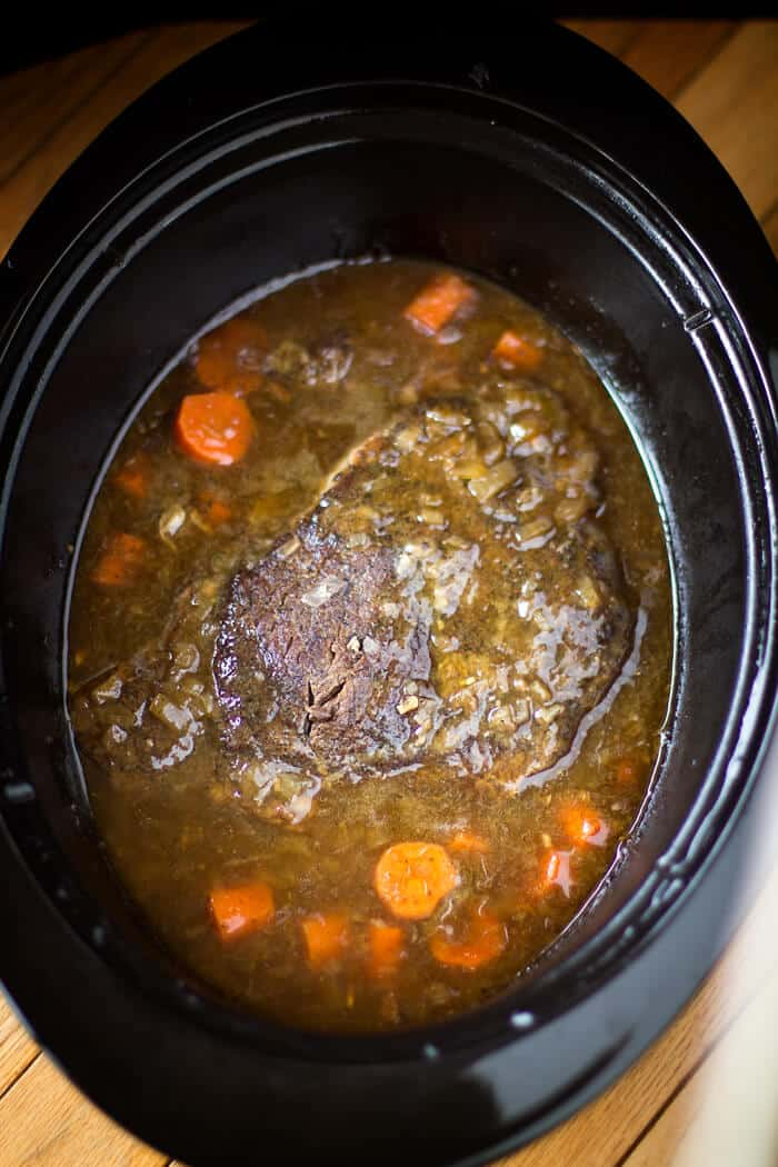 This slow cooker beer braised pot roast is easy to make in the Crock Pot.