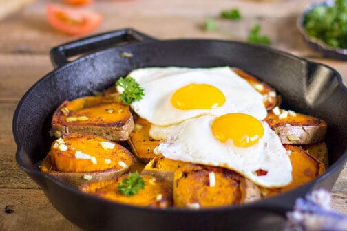 A pan of baked sweet potatoes and eggs.