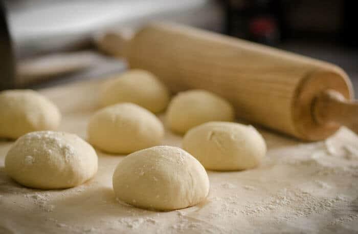 A close up of dough balls