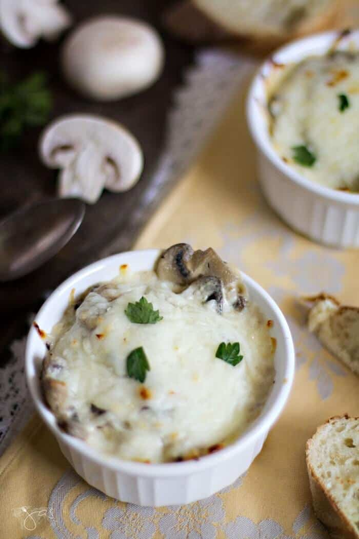 These mini Russian mushroom appetizers are creamy and topped with cheese.