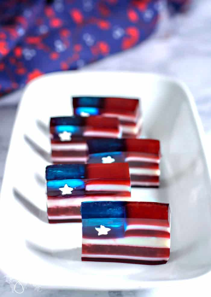 Flag-looking jello dessert for Independence day on a plate.