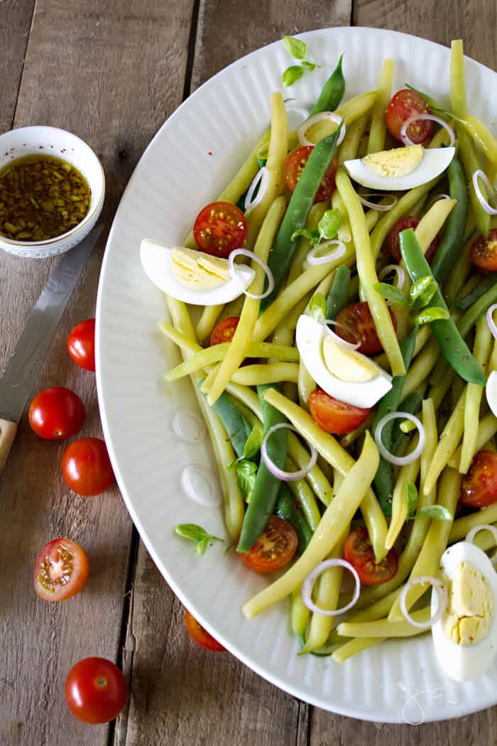 Yummy summer salad with green and yellow wax beans, tomatoes, and eggs that is great warm or cold.
