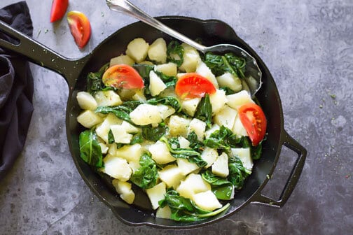 A skillet with vegetables on a counter