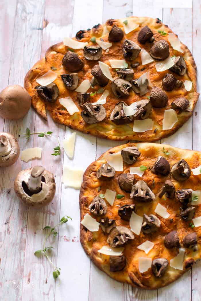 An overhead shot of naan pizza with mushrooms