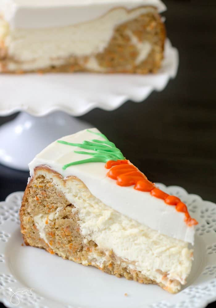 A slice of carrot cake sitting on a white plate.