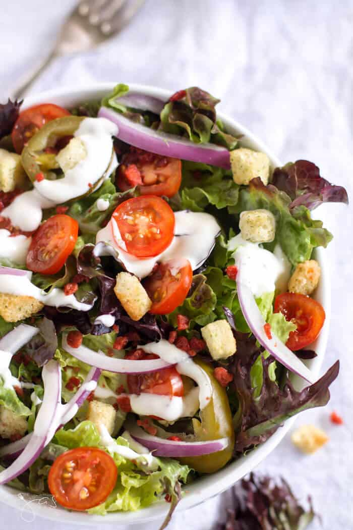 Fresh tomatoes, onions, peppers, bacon bits and croutons come together for a tasty salad.