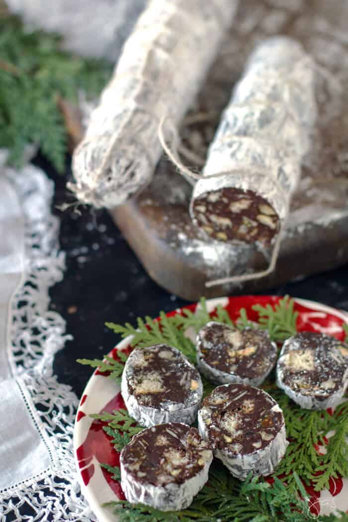 chocolate salami cut up on a christmas plate to make the holidays festive