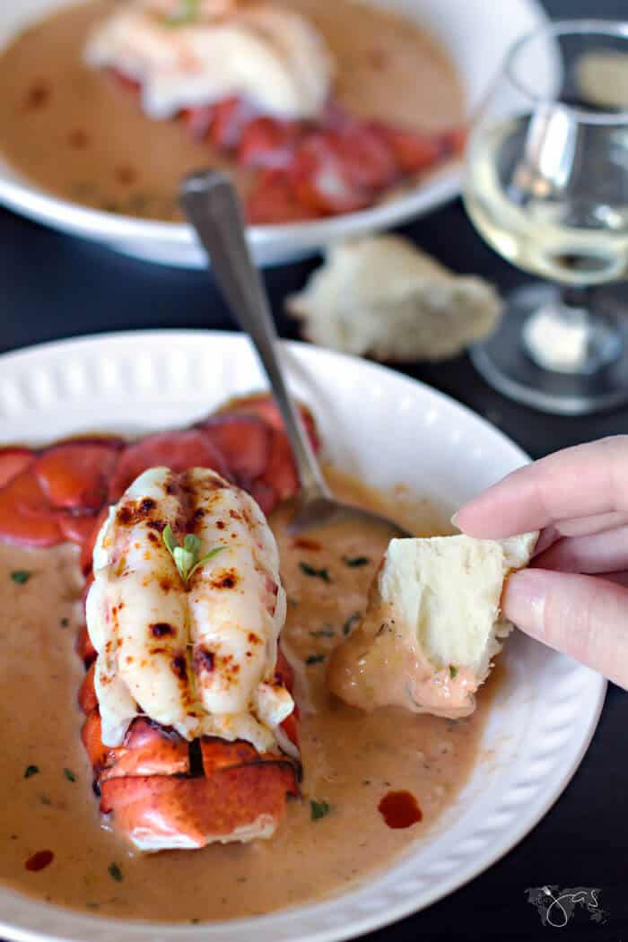 Creamy bisque with smoked salmon and lobster is perfect for dipping crusty bread.