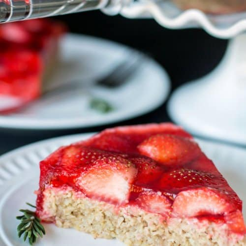 A close up of a slice of oatmeal strawberry cake