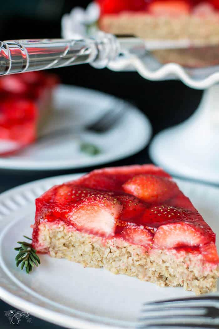 This oatmeal cake pairs well with fresh strawberries.