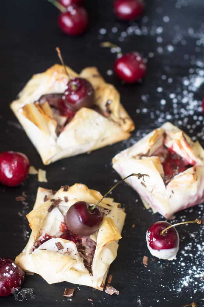 Fillo dessert with cherries on a table and powdered sugar