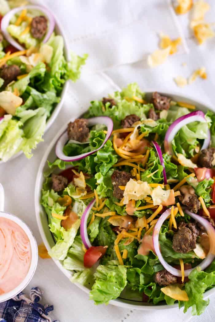 The dressing drizzled over this cheeseburger salad is zesty and full of flavor.
