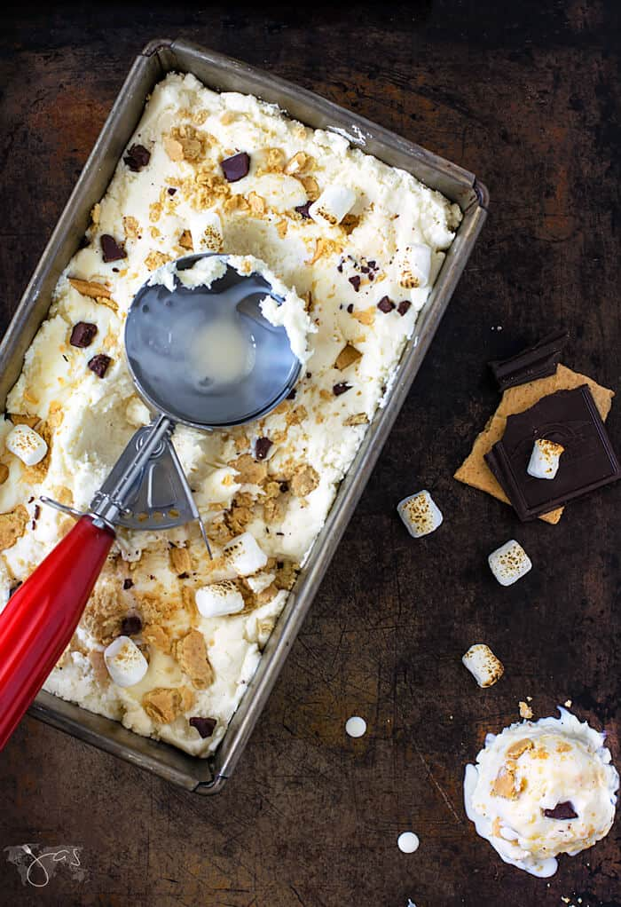 Easy to make s'mores ice cream, in a metal loaf pan with red ice cream scooper