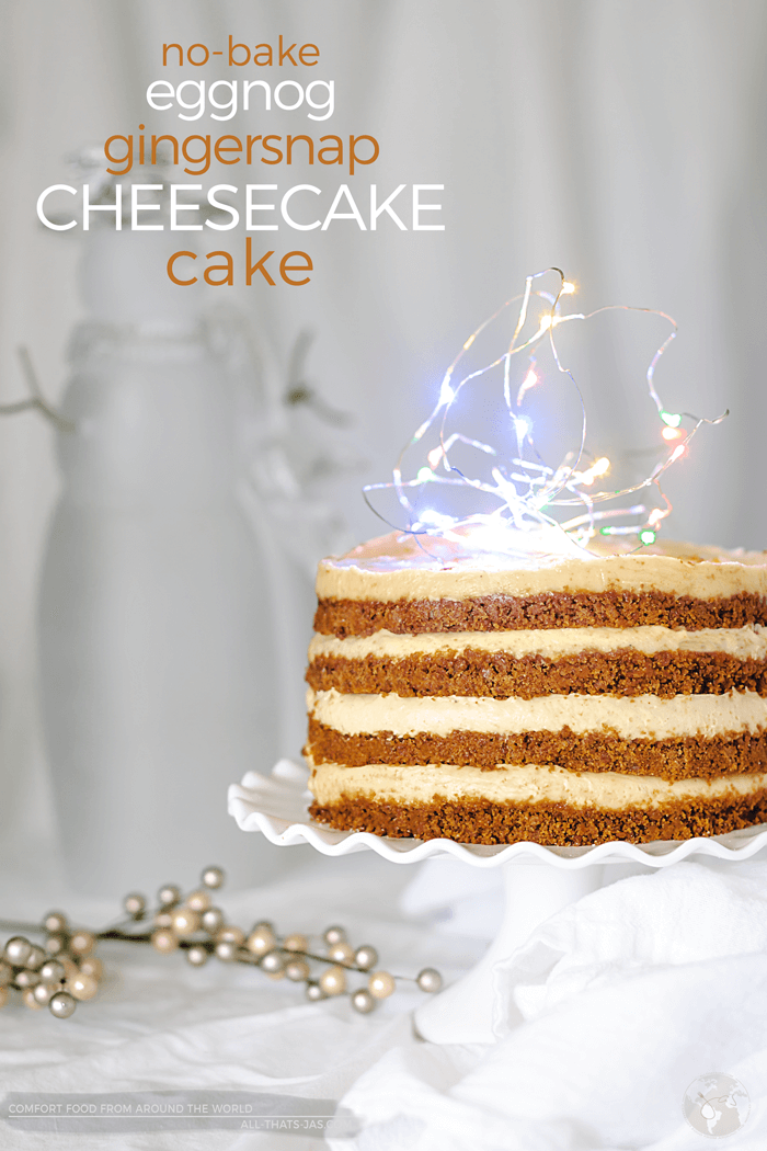 If you love cheesecake and Christmas flavors, I guarantee that you will melt over this no-bake eggnog and gingerbread cheesecake cake. Wow the crowd with this creamy, luscious eggnog cheesecake. The nutmeg and cinnamon aroma in this cake is simply out of this world. | allthatsjas.com | #cheesecake #eggnog #gingersnaps #nobake #holidays #dessert #cake #recipe #fromscratch #allthatsjas #nutmeg #Christmas #cinnamon