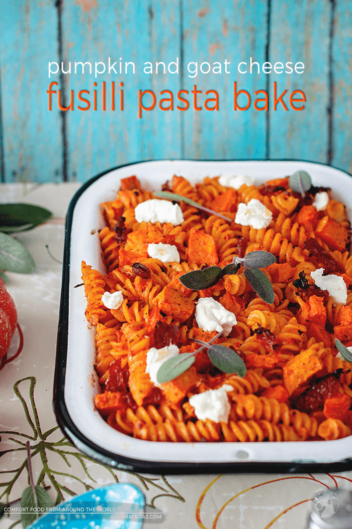 Ready for a different fall-inspired pumpkin recipe? You will love this easy pumpkin and goat cheese fusilli pasta bake. In combination with sage and sun-dried tomatoes, it yields a flavorful and ultimate grown-up pasta casserole. | allthatsjas.com | #pastabake #oven #vegetarian #pumpkin #goatcheese #casserole #comfortfood #worldfood #autumn #fall #noodleswithoutborders #recipes #holidaymeal #thanksgiving #allthatsjas