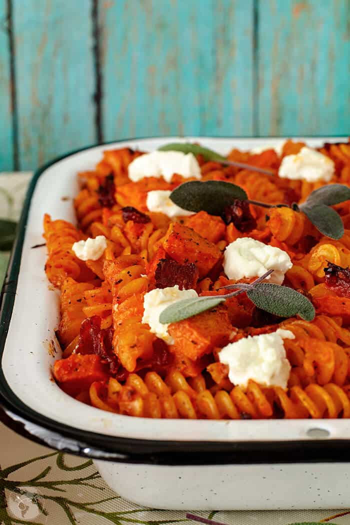 French recipe for delicious vegetarian pasta bake with pumpkin, goat cheese, sage, and sun-dried tomatoes.