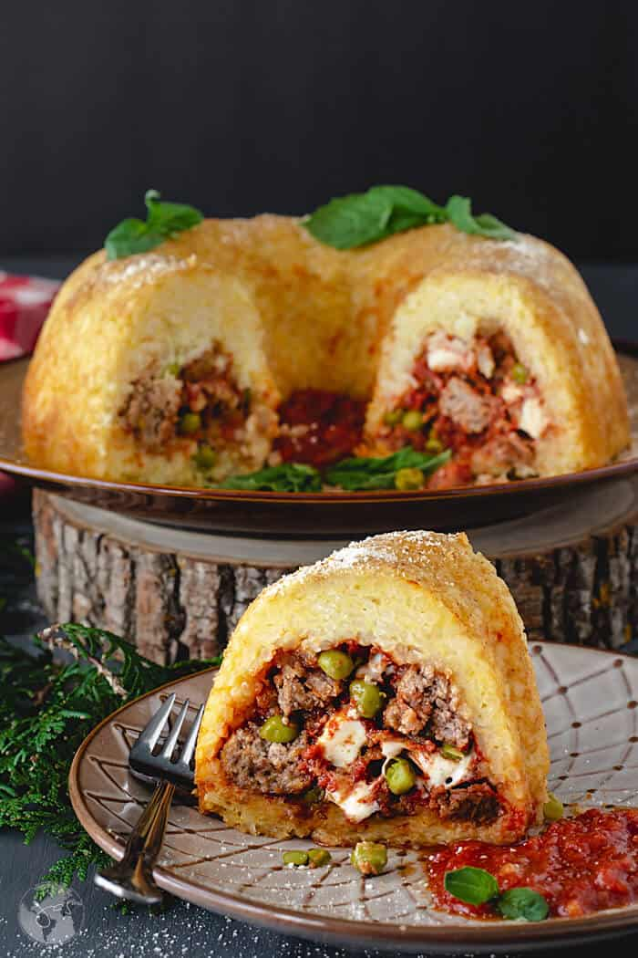 Savory rice bundt cake, filled with sausage, meatballs, and cheese is a traditional Neapolitan dish.