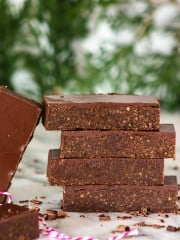 a front shot of no-bake bars stacked on top of each other.
