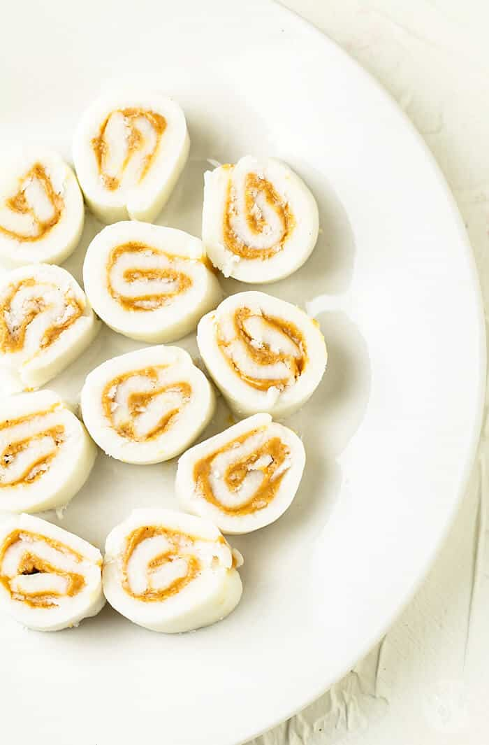 Peanut butter sweet potato pinwheels on a white plate