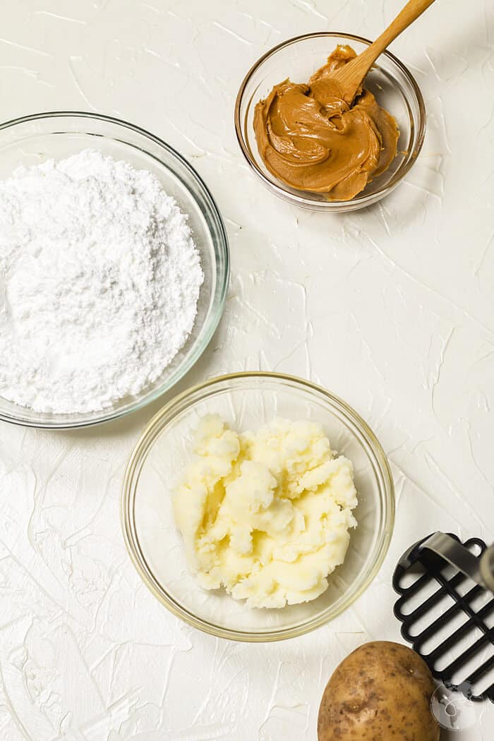 Three ingredients for potato candy: mashed potato, powdered sugar, and peanut butter.