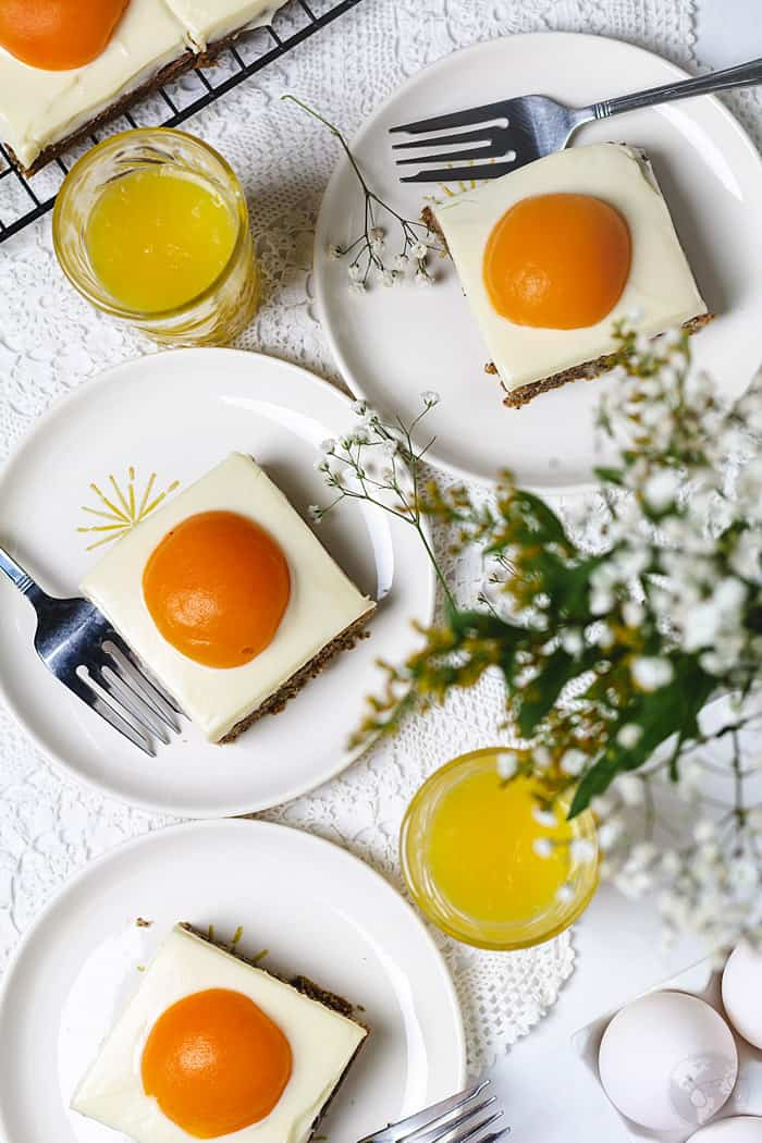 Plated sunny-side up cake with orange juice pictured overhead.