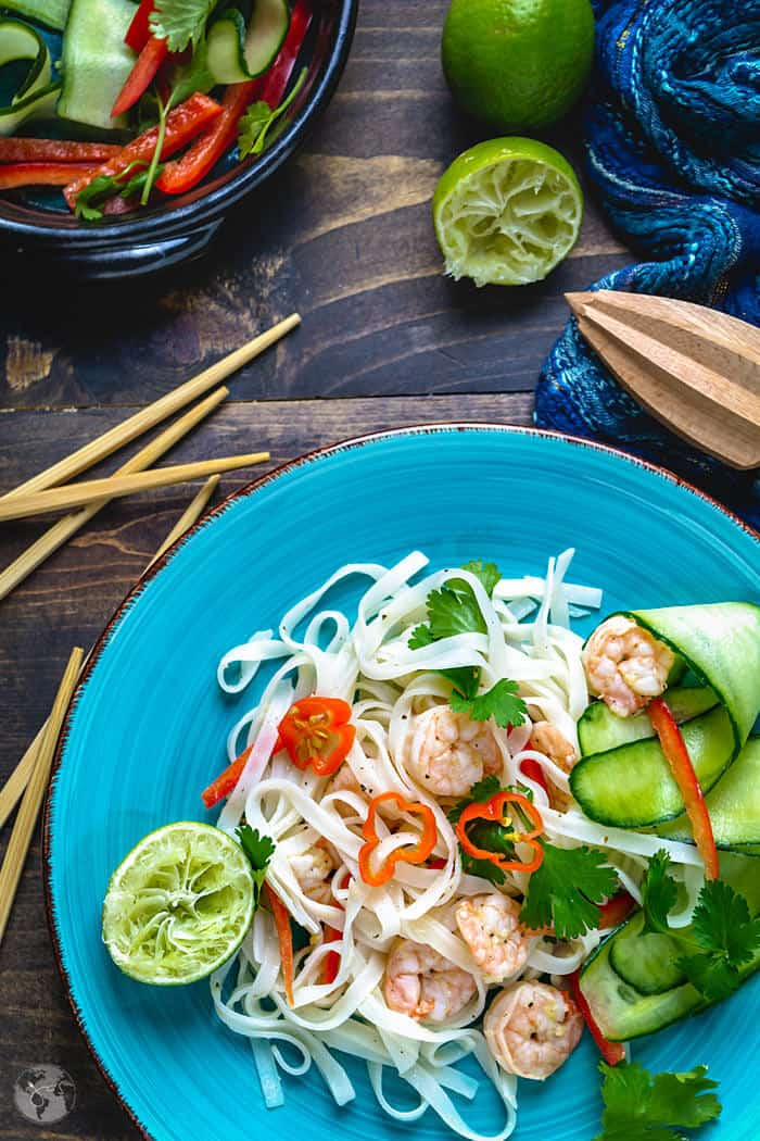 Plated Thai noodle salad with cucumbers and red peppers.