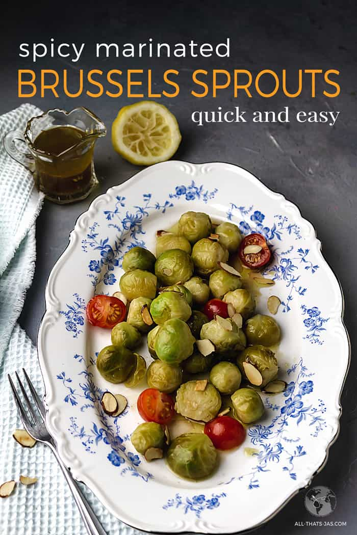 Marinated Brussels sprouts on a oval platter with cherry tomatoes and toasted almonds are super easy and quick to make.