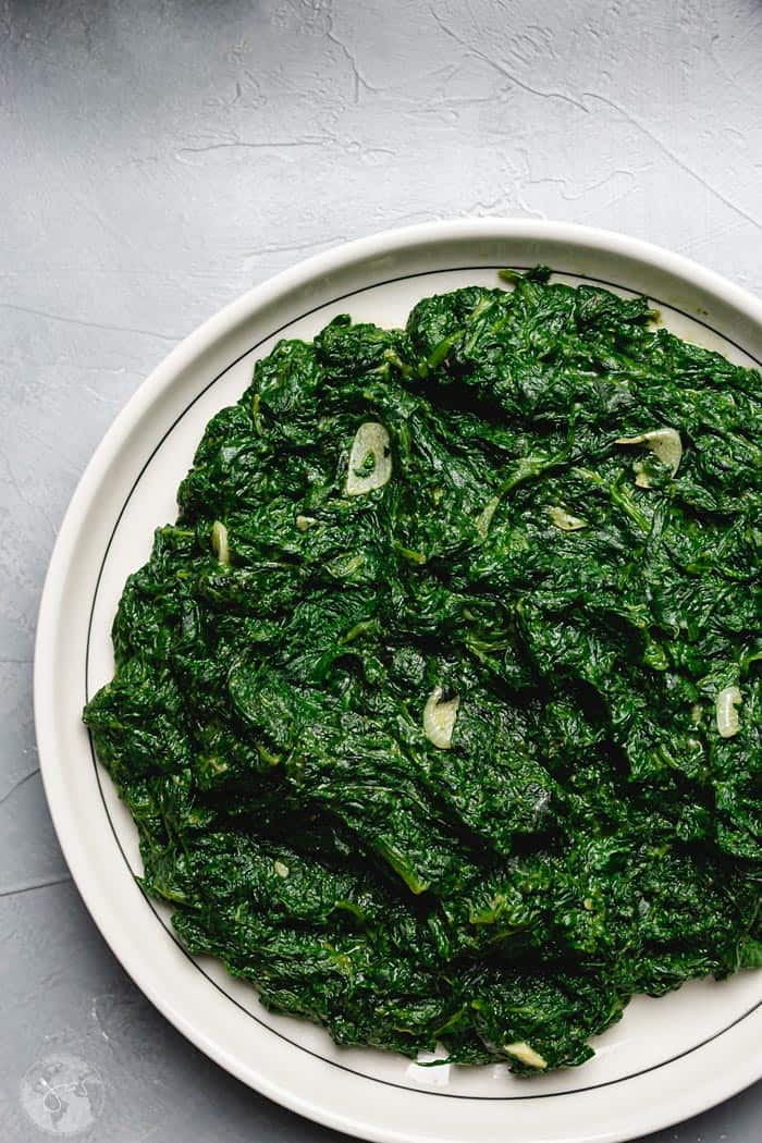 Cooked nettle on a white plate
