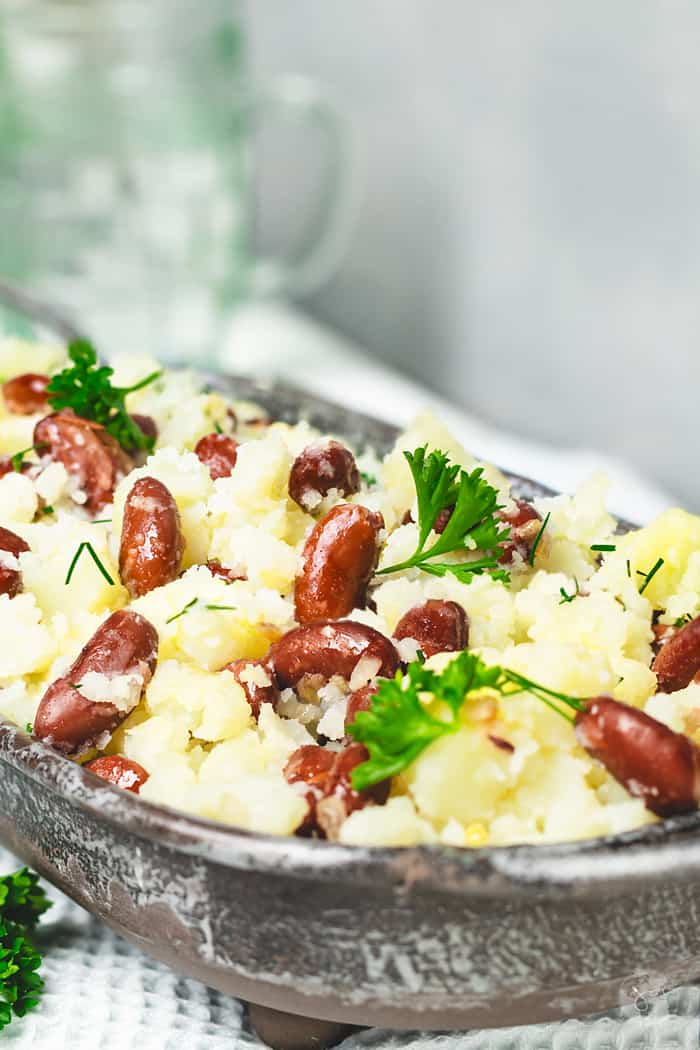 This hearty side dish from belarus is made with potatoes, red beans, onion, garlic, and herbs.