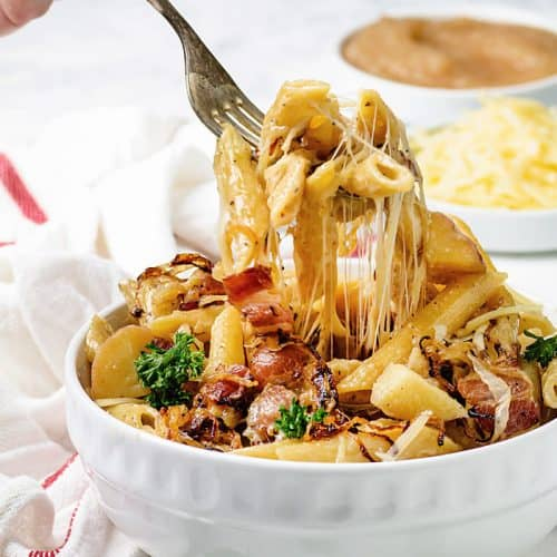 Stretchy cheese with pasta, bacon and onions.