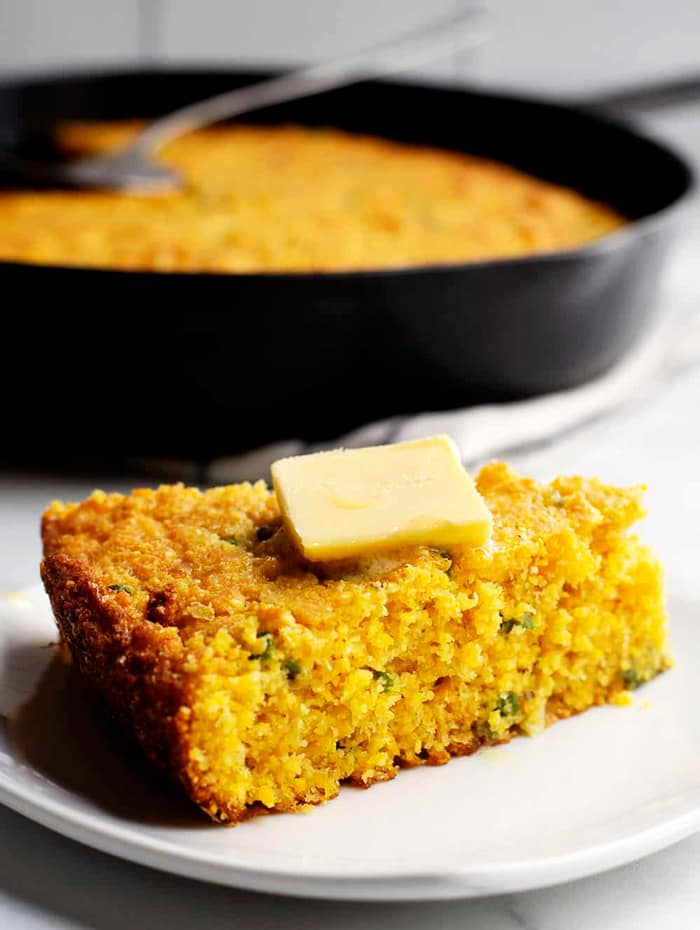 a wedge of cornbread with butter