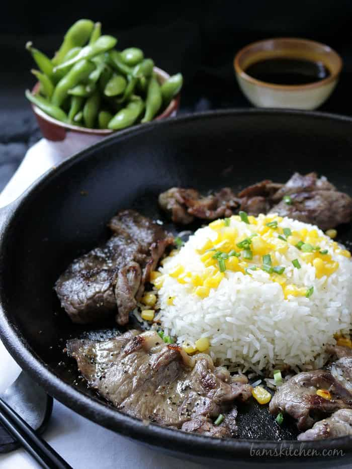 beef steak strips and rice in cast ironware