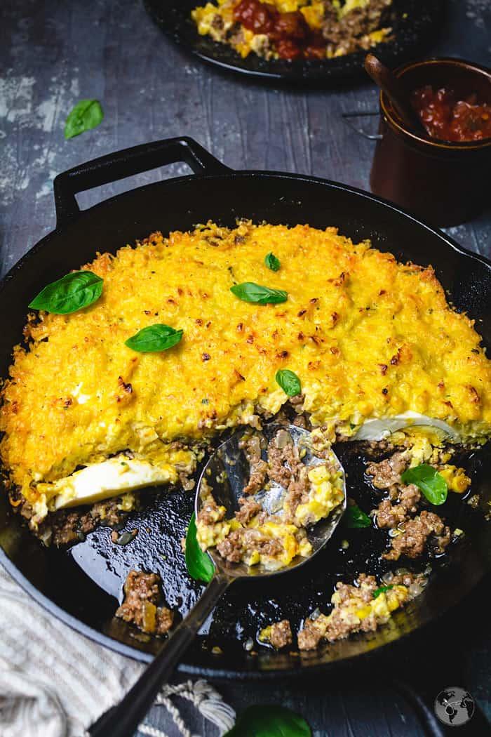 Chilean half-eaten corn shepherd's pie with a serving spoon.