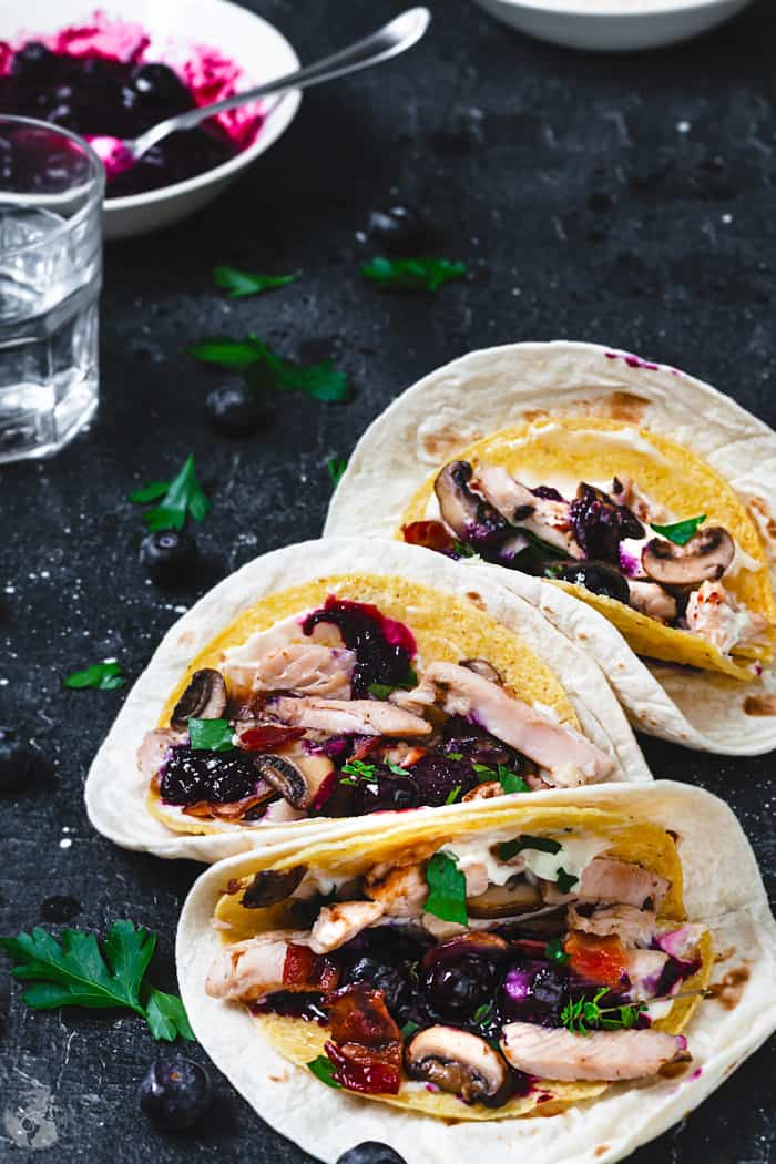 Delicious Thanksgiving turkey leftovers made into a taco, served with blueberry sauce.