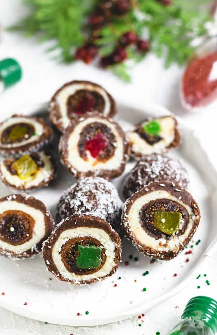 Sliced holiday dessert made with stuffed figs and covered with coconut and chocolate layers