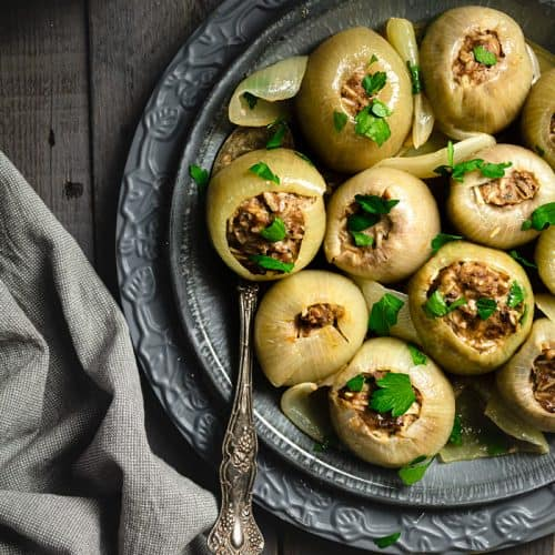Delicious beef-stuffed onions with ground beef and rice mixture.